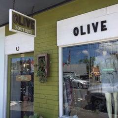 Photo taken at Olive Boutique by Noriyuki M. on 8/19/2015
