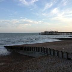 Photo taken at Hastings Pier by Elizabeth on 8/3/2014