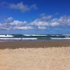 Photo taken at Praia de Imbé by Vinicius T. on 1/17/2013