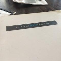 Photo taken at Bravo Brasserie Restaurant by Chris H. on 3/16/2014
