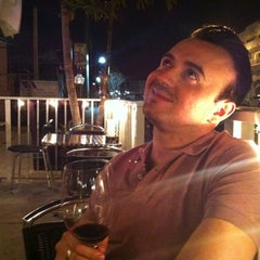 Photo taken at Naked Grape Wine Bar by Juan A. on 3/4/2012