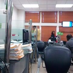 Photo taken at Dirección General de Impuestos Internos (DGII) by Robert N. on 11/29/2013