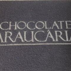 Photo taken at Fábrica Chocolate Araucária by Fernanda S. on 5/18/2013