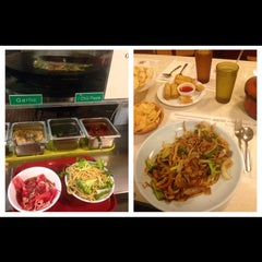 Photo taken at Golden Palace Mongolian BBQ by Laura L. on 8/7/2014
