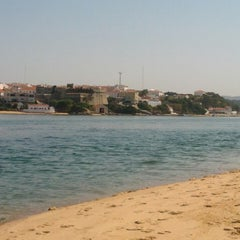 Photo taken at Praia de Vila Nova de Milfontes by Tiago G. on 7/4/2013