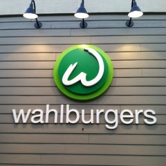 Photo taken at Wahlburgers by Alexandra G. on 6/21/2012