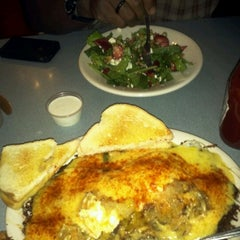 Photo taken at The Uptowner Cafe on Grand by Kamillah E. on 8/25/2012
