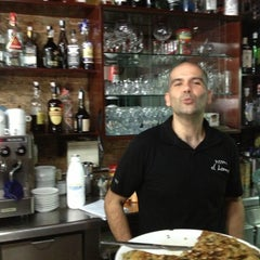 Photo taken at Pizzeria Hornero by Lawrence C. on 5/27/2013