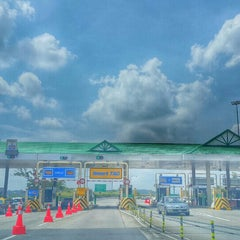 Photo taken at Plaza Tol Ayer Hitam by UmiAbiNini on 7/23/2015