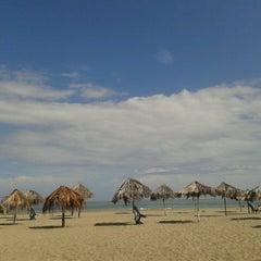 Photo taken at Playa Pelúa by Corina A. on 12/25/2013