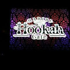 Photo taken at Habibi Hookah Cafe by Ahmed M. on 4/28/2014