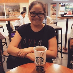 Photo taken at Starbucks by Magnolia D. on 6/10/2015