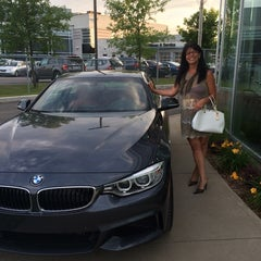 Photo taken at Park Avenue BMW by Marie-Claire D. on 7/15/2014