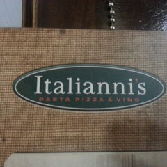 Photo taken at Italianni's by Julio C. on 12/15/2012