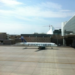 Photo taken at Frontier Airlines (Gates 24 - 32) by Galen F. on 7/7/2013