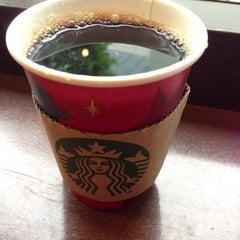 Photo taken at Starbucks Coffee 茅場町店 by Masahiro on 12/3/2012