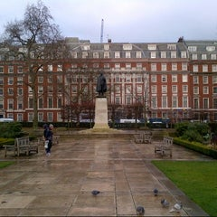 Photo taken at Grosvenor Square by Olivera on 12/21/2012