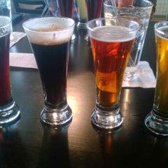 Photo taken at Destihl Restaurant & Brew Works by Brandon H. on 12/31/2013