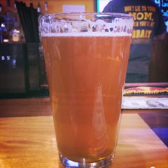 Photo taken at The Library Sports Grill and Brewery by Brady F. on 4/25/2015