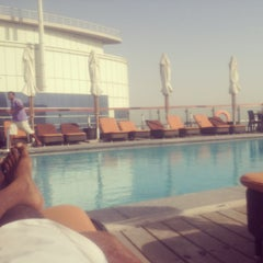 Photo taken at Hilton Dubai Roof Pool by Prashanth K. on 8/31/2013