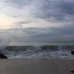 Photo taken at Tegal Wangi Beach by Andrew K. on 1/12/2016