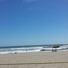 Photo taken at Playa Bonfil by Ernesto M. on 7/25/2013