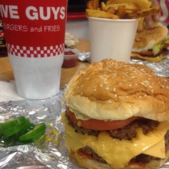 Photo taken at Five Guys by Mariana N. on 12/26/2014