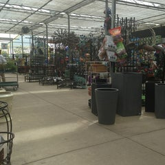 Photo taken at Farmer John's Greenhouse by Jesse P. on 7/6/2013
