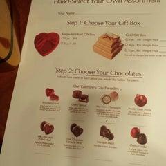 Photo taken at Godiva Chocolatier by Jason V. on 2/14/2014