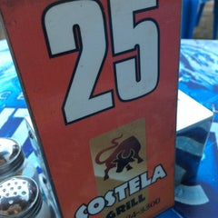 Photo taken at Costela Grill by Fabíola O. on 2/6/2015