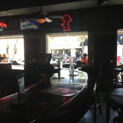 Photo taken at Island Dogs Bar by Matt T. on 3/17/2013