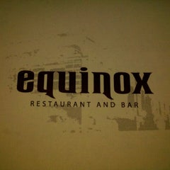 Photo taken at Equinox Restaurant & Bar by Rebecca S. on 3/12/2011
