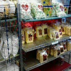 Photo taken at Knight's Gourmet Popcorn by Craig F. on 12/30/2011