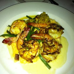 Photo taken at Emeril's by Erin S. on 7/24/2011
