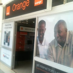 Photo taken at Africell  - Garden City by Amako A. on 3/2/2012