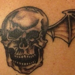Photo taken at Axiom Tattoo and Piercing by Kim C. on 6/7/2013