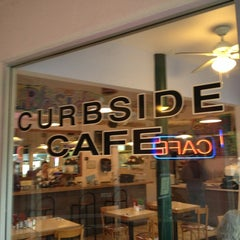 Photo taken at The Curbside Cafe by Andre C. on 12/26/2012