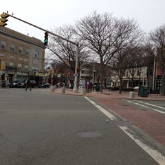 Photo taken at Davis Square by Onur Ö. on 3/31/2013