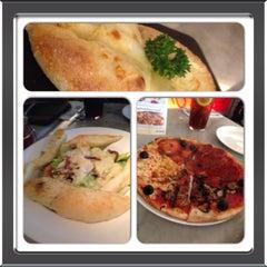 Photo taken at Pizza Marzano by irma i. on 2/2/2014