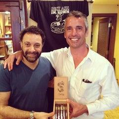 Photo taken at Cigar Exchange by Ruben G. on 4/14/2014
