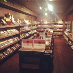 Photo taken at Churchill's Fine Cigars by Ruben G. on 3/19/2014