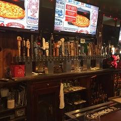 Photo taken at Pitcher's Pub by Michael L. on 3/18/2015