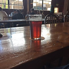 Photo taken at Lucky Labrador Beer Hall by Eric L. on 9/17/2015
