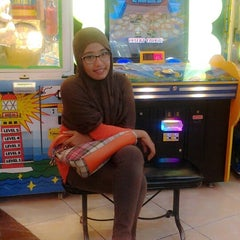 Photo taken at Timezone by Nadra K. on 3/28/2014