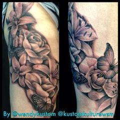 Photo taken at Kustom Kulture Tattoo Studio by Wendy B. on 1/28/2015