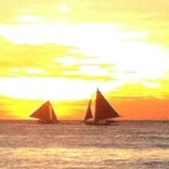 Photo taken at White Beach by Juan E. on 11/2/2012