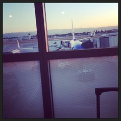 Photo taken at Gate 22 by Stacy D. on 8/23/2013