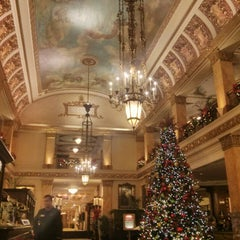 Photo taken at The Pfister Hotel by Travel A. on 11/22/2013