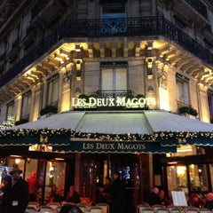 Photo taken at Les Deux Magots by mallowe on 12/16/2012
