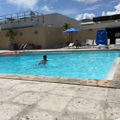Photo taken at Hilton Hotel Rooftop Pool by Renê Gilberto F. on 8/22/2015